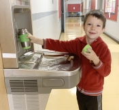boy fills up water bottle at parkview